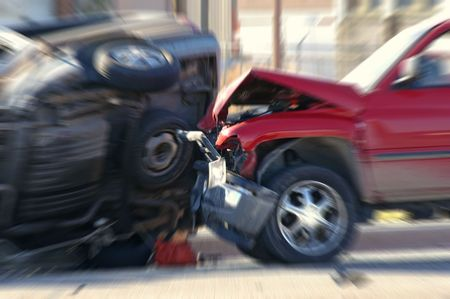 Two cars smashed together in a car accident with rollover