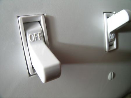 off:       closeup of a power switch in the off position