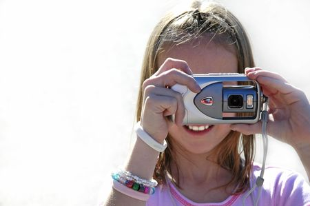 Girl photographer taking pictures with a digital camera Stock Photo - 597053