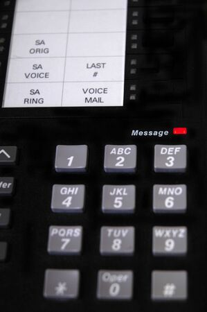 voicemail: Closeup of telephone keypad and messages light glowing red