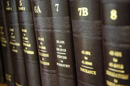 statute: Close up of several volumes of law books of codes and statutes Stock Photo
