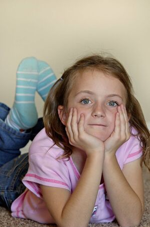 sweetly: Young girl with hands on face looking sweetly