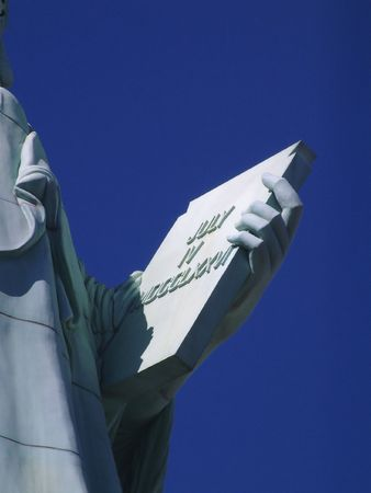 Closeup of the Statute of Liberty holding slate of the Fourth of July