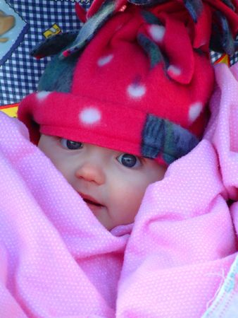 warm clothes: Portrait of baby bundled up in winter clothing to stay warm