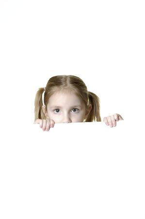 ponytails: Little girl looking over the edge of a white sign she is holding