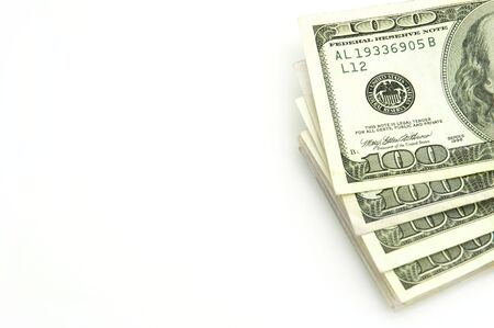 Closeup of stack of cash isolated on white background photo