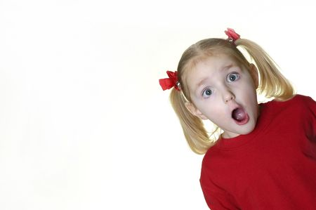 Little girl dressed in red making faces expressions photo