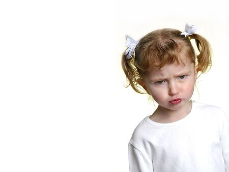 ponytails: Little girl dressed in white making faces expressions