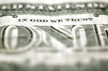 we: Closeup of cash bill with words In God We Trust