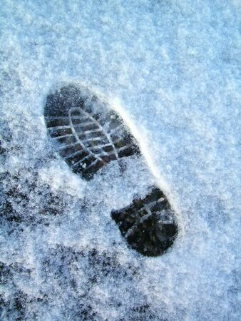 icey: Isolated footprint in the crusty icey snow Stock Photo