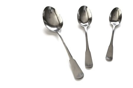 Several Sizes of Spoons Isolated on White Background Imagens