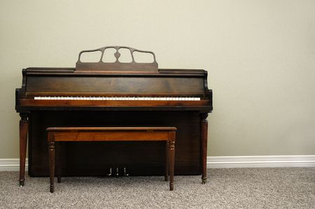 Interior view of piano and bench in a home Stock Photo - 790176