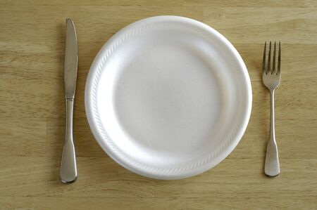 Isolated knife fork and white plate Imagens