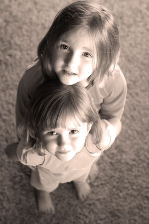 focused: Portrait of two little girls focused on eyes and faces Stock Photo
