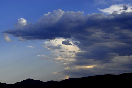 View of white and gray storm clouds in blue sky Stock Photo - 1236766