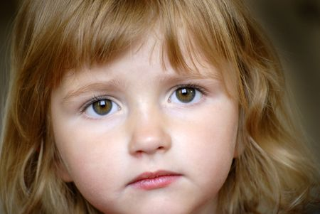 trusting: Little girl portrait focused on eyes and face