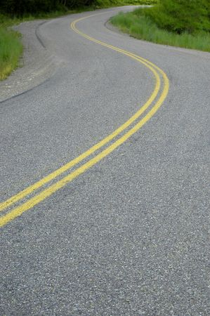 Country road with painted double yellow lines photo