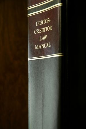 statutes: Close up of a single law book of codes and statutes Stock Photo
