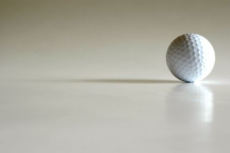 smooth: Isolated golf ball on white background with reflection and shadows Stock Photo