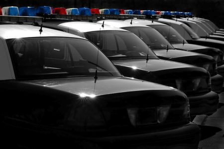 line up: Row of Police Cars with Blue and Red Lights