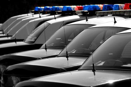 Row of Police Cars with Blue and Red Lights photo