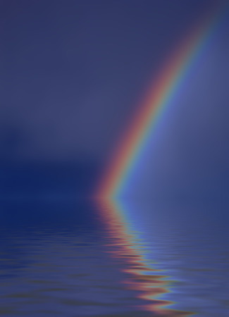 Colorful bright rainbow set against stormy sky with reflection photo