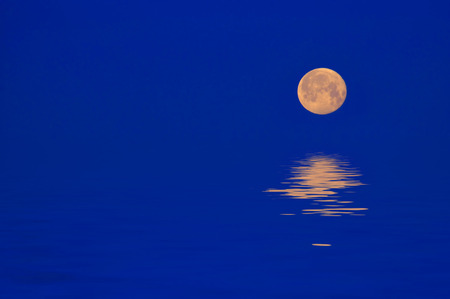 Full Moon Rising Over Reflection in Water Stock Photo - 1511544