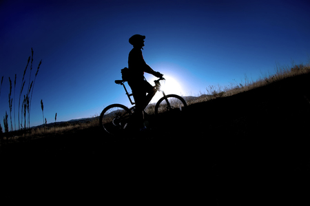 Mountain biking up a trail in the mountains Stock Photo - 1576165