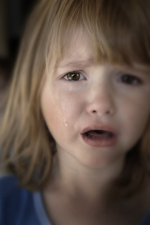 sincere girl: Portrait of little girl crying with tears rolling down her cheeks