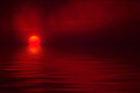 Sunset reflecting orange and red in water Stock Photo - 1675199