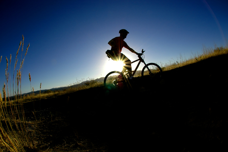 helmet seat: Mountain biking up a trail in the mountains