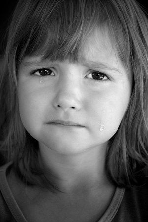 sad child: Portrait of little girl crying with tears rolling down her cheeks