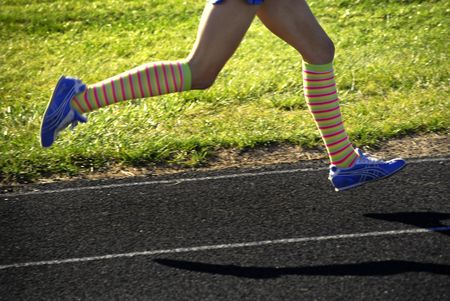 quickness: Runner running a race around a track with  lines