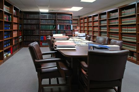 Conference room table with several leather chairs and shelves of books Stock Photo - 2100415