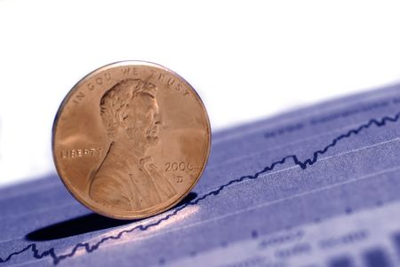 Closeup of pennies with graph and stock chart in background Imagens