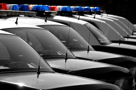 many windows: Row of Black and White Police Cars with Blue and Red Lights Stock Photo