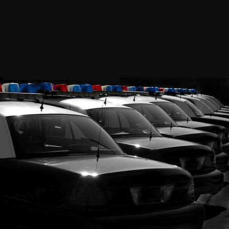 glint: Row of Police Cars with Blue and Red Lights