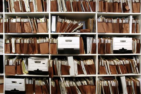 archives: Office shelves full of files and boxes Stock Photo