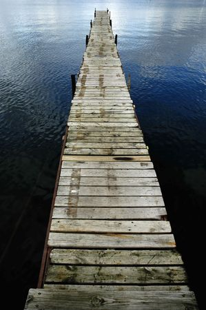 Dock floating in blue lake with water ripples around  photo
