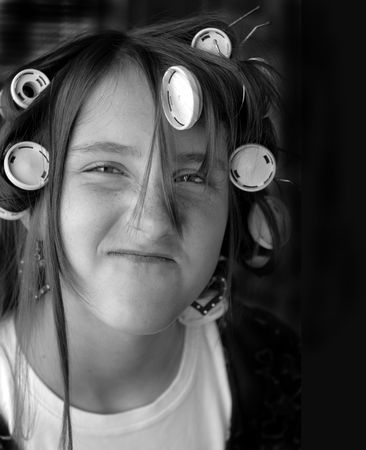 bugging: Portrait of teenage girl with curlers in her hair