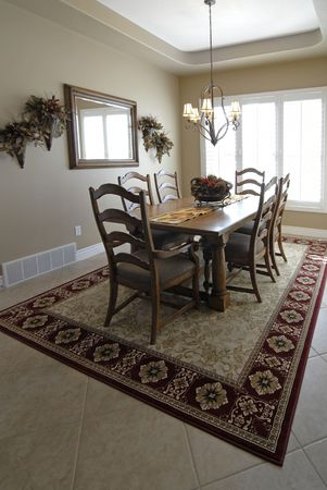 View of interior of dining room in house with table and chairs Stock Photo - 2170846