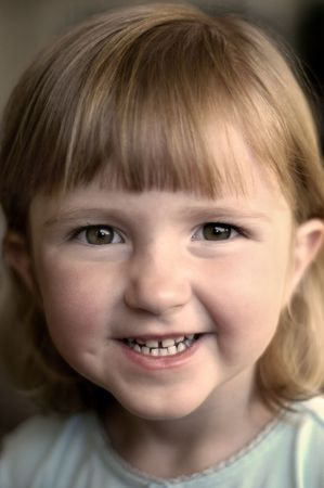 Little girl smiling portrait focused on eyes and face Stock Photo - 2170836
