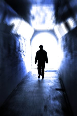 Long tunnel walkway with person at the end