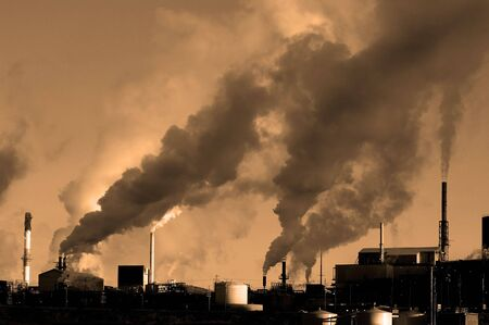 carcinogen: Detail of pollution coming from factory smoke stacks Stock Photo