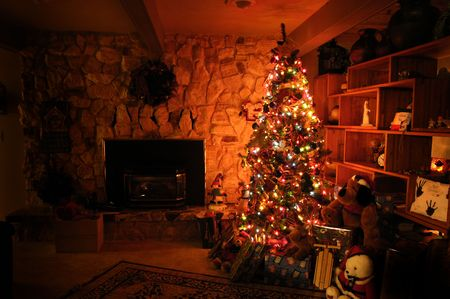 Front room decorated for christmas with christmas tree stockings and fireplace photo