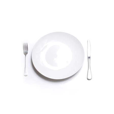 sharpness: Knife and fork silverware with white plate on white background