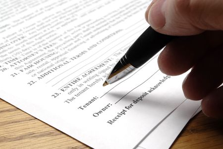 purchase: Hand holding pen signing a purchase contract or agreement