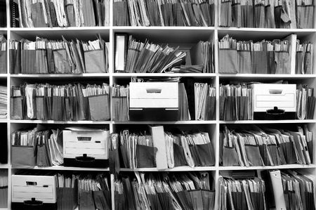 messy: Office shelves full of files and boxes Stock Photo