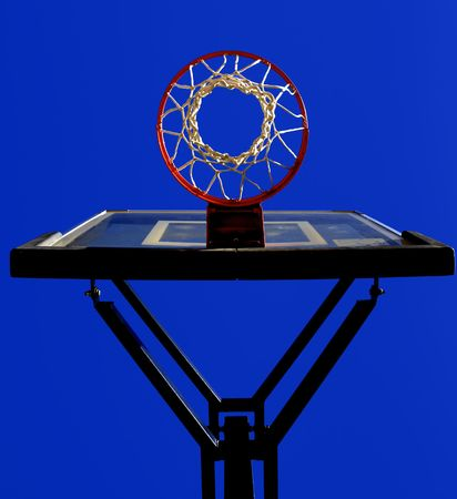 net: Basketball hoop and net with blue sky in background