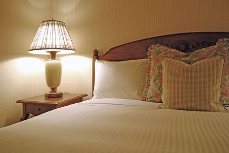 kingsize: Group of several pillows on a bed with headboard